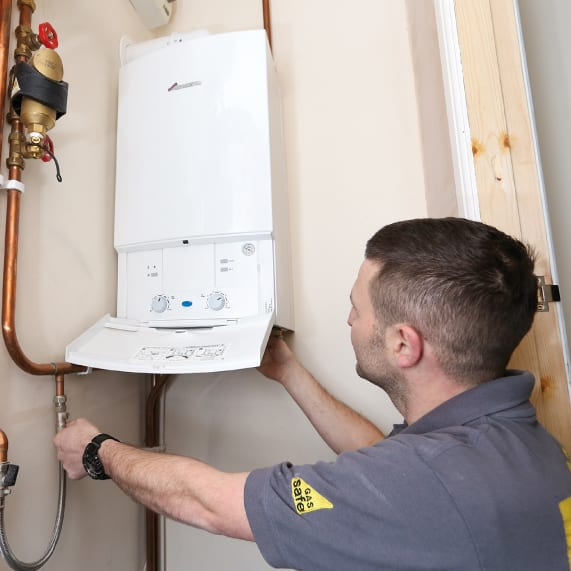 central heating servicing - boiler with a man