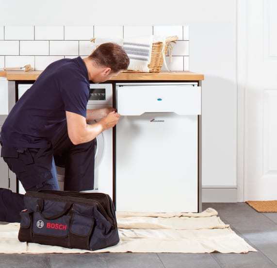 plumber servicing boiler - oil boiler servicing